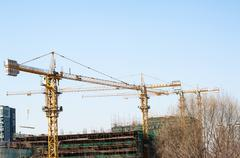 tower cranes in the consreuction field - stock photo