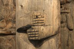 Historic old Alaska Indian Totem Pole hands Stock Photos