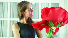 Woman happy giant flower look looking Stock Footage