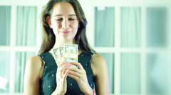 Woman offering money pay paying Stock Footage