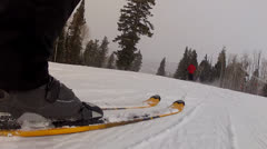 Low shot of skiers in a storm Stock Footage