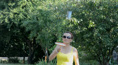 Young woman playing badminton Stock Footage