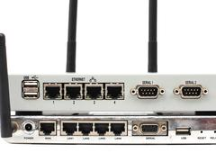 Connect the ethernet port on the back of the router. Stock Photos