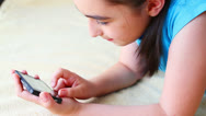 Stock Video Footage of Little girl playing on smart phone
