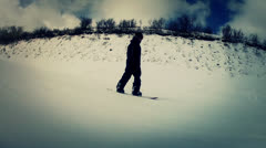 A snow boarder at park city Stock Footage