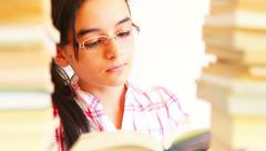Teenage girl studying with textbooks Stock Footage