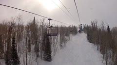 Riding chairlift in snow storm Stock Footage