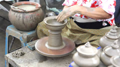 Close up of hands making earthen jar on a wheel in traditional Thailand style Stock Footage