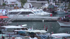 Motor yacht leaving Kaleici harbor in the evening Stock Footage