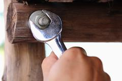 wrench tighten the nut on use - stock photo
