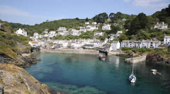 Boat in beautiful Cornwall harbour Polperro Stock Footage