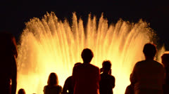 Backligths of people visiting montjuic fountain in barcelona Stock Footage