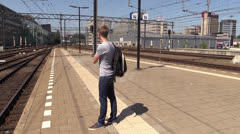 Impatient student waiting for train, steadicam shot - stock footage