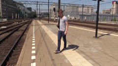 Impatient student waiting for train - stock footage