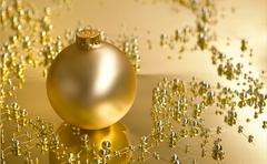 golden christmas ornaments and decorations - stock photo