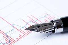 Pen and business graph Stock Photos