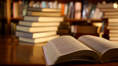 Open book in a library Stock Footage