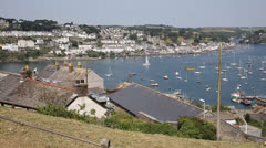 River Fowey Cornwall from Polruthan with boats PAN Stock Footage