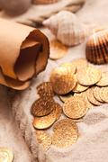 Treasure map and golden coins Stock Photos