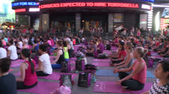 Yoga In Time Square Pan Stock Footage
