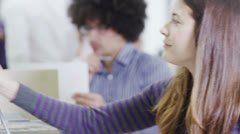Attractive and fashionable young business team at work in a contemporary office Stock Footage