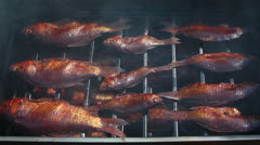 Smoked fish in smoking shed Stock Footage