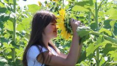 Girl and sunflower Stock Footage