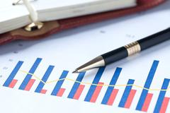 financial graph and pen - stock photo