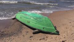 old green wooden boat on sea beach sand - stock footage