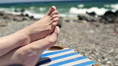 Female feet on sunbed by the sea HD - stock footage