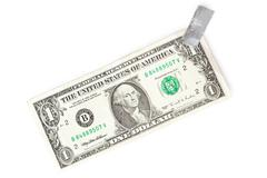 Paper currency and tape Stock Photos