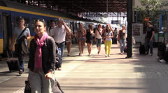 Crowd at railway station Stock Footage