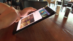 Checking facebook on iPad mini Stock Footage