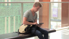 Young attractive man working on iPad Stock Footage