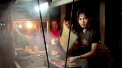 Cooking of the Chicken Satay by the street vendor Stock Footage