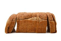 A loaf of whole grain bread on white Stock Photos