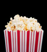 Popcorn container on a black background Stock Photos
