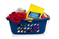 blue laundry basket full of dirty clothes - stock photo