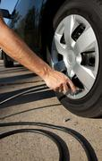 airing up a car tire - stock photo