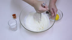 Chef beating cream, mascarpone, and sugar together Stock Footage