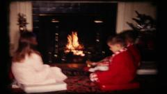 Family Christmas time around the fireplace, 51 vintage film home movie Stock Footage