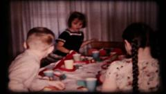 57 birthday party guest gather at table for cake - vintage film home movie Stock Footage