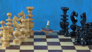 Stock Video Footage of colorful wooden whirligig  on chessboard with chessmen