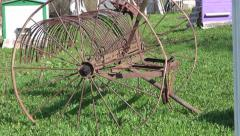 Old rusty agriculture horse rake tool in farm garden Stock Footage