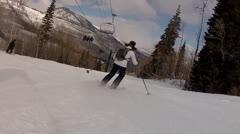 Following skier on mountain Stock Footage