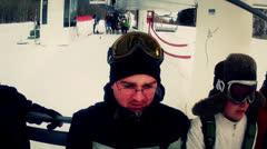 Skiers riding on ski lift Stock Footage