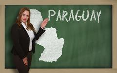 Stock Photo of teacher showing map of paraguay on blackboard