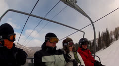 Skiers riding on a ski lift Stock Footage