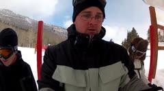 Skiers getting on ski lift Stock Footage