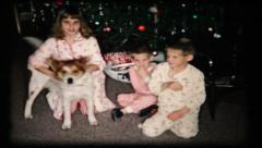 60 kids with dog aroung the Christmas tree - vintage film home movie Stock Footage